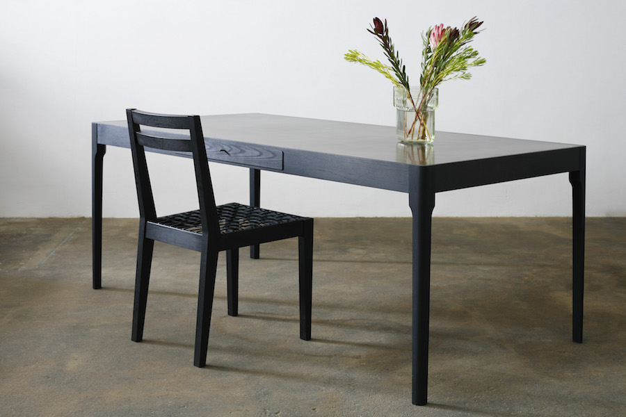 http://www.jamesmudge.com/files/gimgs/1_brass-top-tapered-leg--dark-charcoal-with-chair.jpg