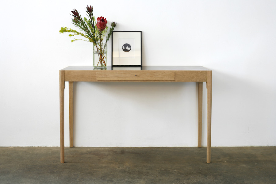 http://www.jamesmudge.com/files/gimgs/1_brass-top-tapered-leg-table.jpg